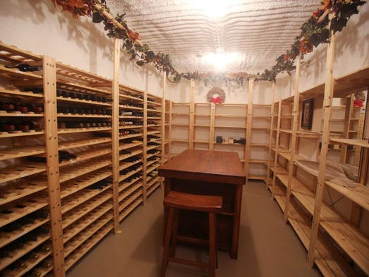 Log house in the thumb is a hunter 39 s haven for Walk in wine cellar