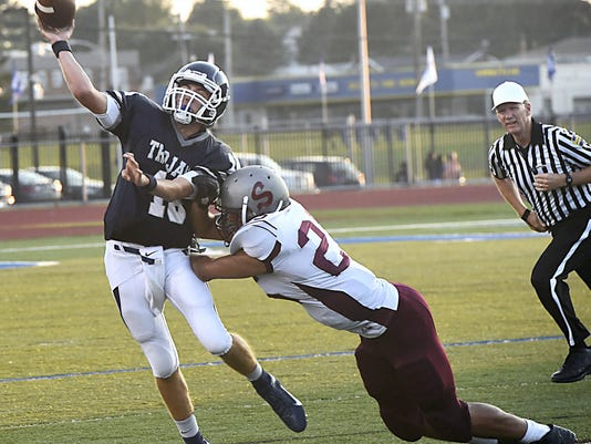 Chambersburg's Hunter Leedy, left, is pressured by Dante Nighbert, of Shippensburg, during Week 2 of the high school football season. (Photo by Ryan Blackwell -- Public Opinion)