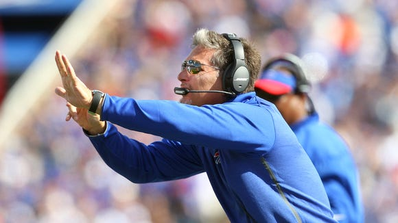 Bills defensive coordinator Jim Schwartz calls a play form the sideline.