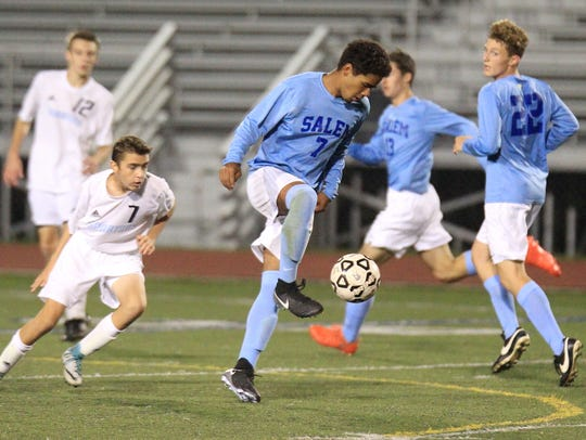 Controlling the ball during Thursday's match is Salem