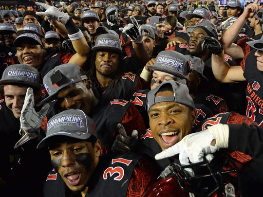 Dec 5, 2015; San Diego, CA, USA; The San Diego State Aztecs celebrate after the Aztecs beat the Air Force Falcons 27-24 to win the Mountain West Conference at Qualcomm Stadium.