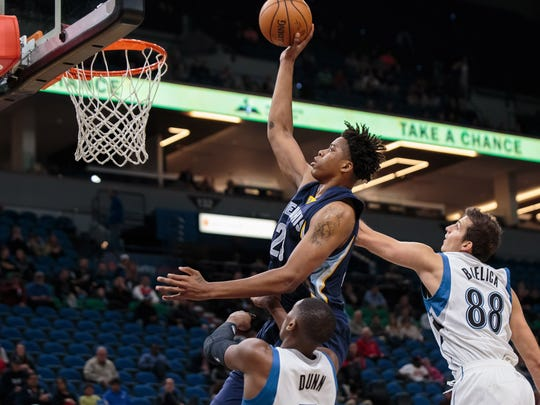 Memphis Grizzlies forward Deyonta Davis (23) shoots in the second quarter against the Minnesota Timberwolves forward Nemanja Bjelica (88) at Target Center in Minneapolis on Wednesday.