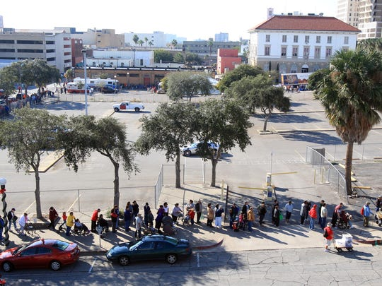 A line of people wraps around two city blocks Saturday, Nov. 17, 2012 for the annual Thomas J. Henry Turkey Giveaway in downtown Corpus Christi.