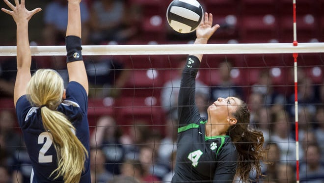 Yorktown's Kenzie Knuckles sends the ball over the net against Providence in the Class 3A state championship game. Knuckles was named an All-American as a sophomore.
