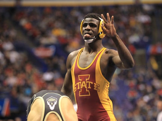 Iowa State's Earl Hall celebrates his 11-5 win over Purdue's Danny Sabatello at 133 pounds during the second session of the NCAA Championships in St. Louis, Mo. on Thursday, March 19, 2015.  David Scrivner / Iowa City Press-Citizen