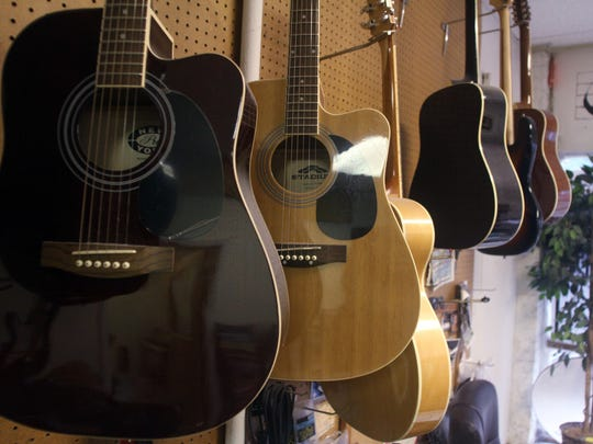 Guitars are displayed, Thursday, September 10, 2015, at the North Brunswick School of Music in Milltown, NJ.