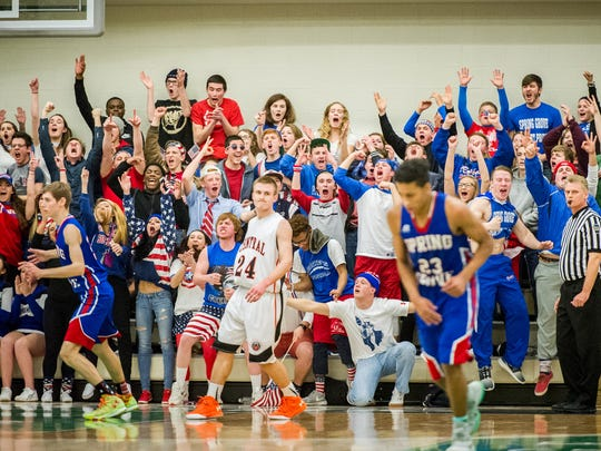 The Spring Grove student section erupts after a string of 3-pointers by Spring Grove's Eli Brooks, right, during the YAIAA boys' basketball championship game in February. Student section leader Austin Piety is in the front row wearing American flag shorts.