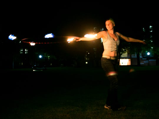 Willamette University senior Jo Kasler dances with a fire hoop at a Poi Club meeting on April 14, 2016. Kasler has been working with poi since middle school and is a past president of the club at Willamette. She did not spin fire until she was in college.