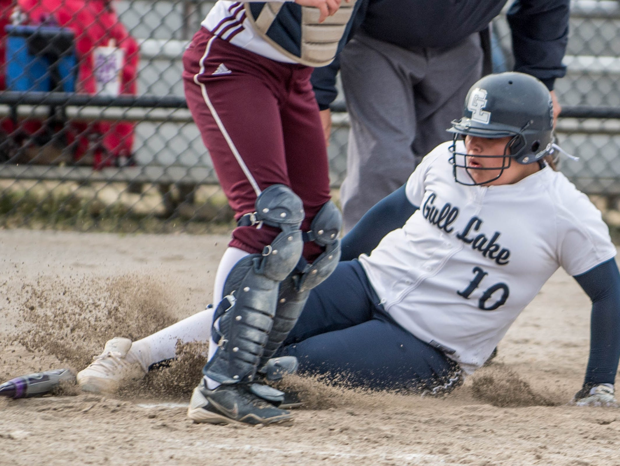 Gull Lake's Shelby Martell slides into home plate during the Gull Lake Invitational on Saturday.