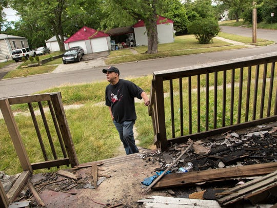Andre Jackson, of Flint, stands outside of a house