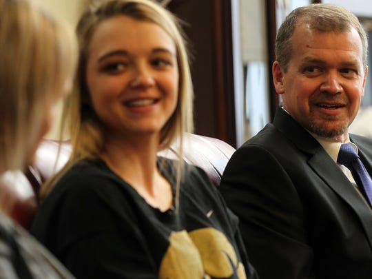 Jeff Disterhoft looks on as he and his wife, Missy,
