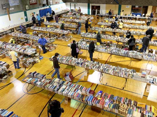 About 60,000 books are available during the 63rd annual YMCA Used Book Sale in Salem on Saturday, March 4, 2017. The sale continues Sunday with readers able to buy all they books they can fit into a bag for $3 and a box for $5.