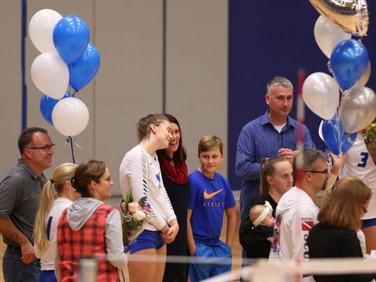 McNary seniors are honored with their families before the start of the South Salem vs. McNary volleyball game at McNary High School in Keizer on Thursday, Oct. 19, 2017.