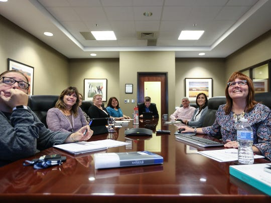 Human Resources Manager Marne Davies, right, leads a monthly meeting for employee development with the Adrian office at the Kapnick Insurance Group office in Ann Arbor.