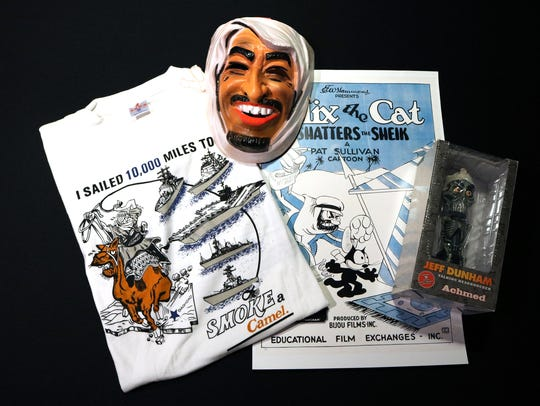 """A collage of items from the """"Them"""" exhibit at the Arab"""