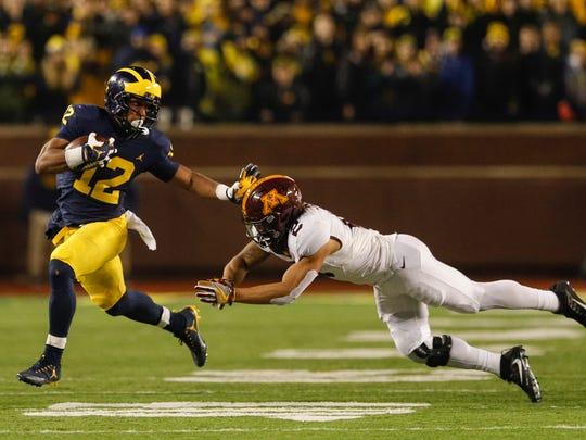 Nov. 4: Michigan running back Chris Evans (12) is and