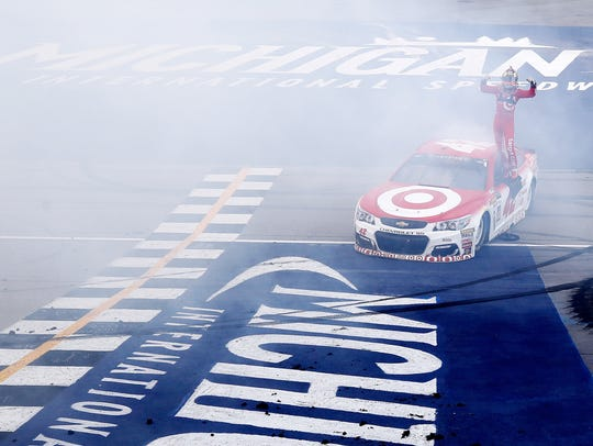 Kyle Larson emerges from his car after winning the