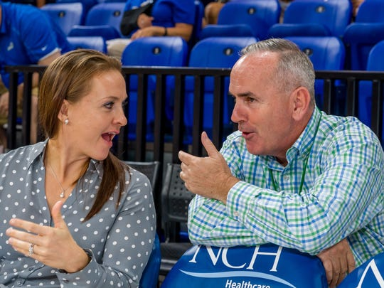 FGCU athletic director Ken Kavanagh (shown chatting with women's assistant Chelsea Banbury) has been able to vastly improve the salaries of his basketball coaches and their operating budgets.