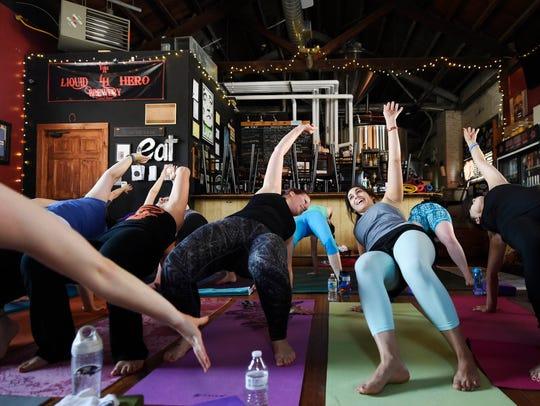 Yoga practitioners Jamie Beek of Springettsbury Township,