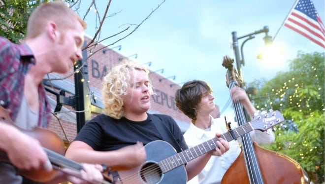The North End Honeys busk the evening of July 1, 2015, on Church Street in Burlington.