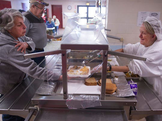 Sarah Zieman, left, is served lunch by volunteer Nancy Horn at The Gathering Place Wednesday afternoon.