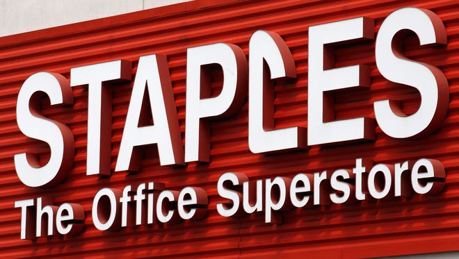 Staples plans to close 140 stores this year.(AP, Rick Browner)