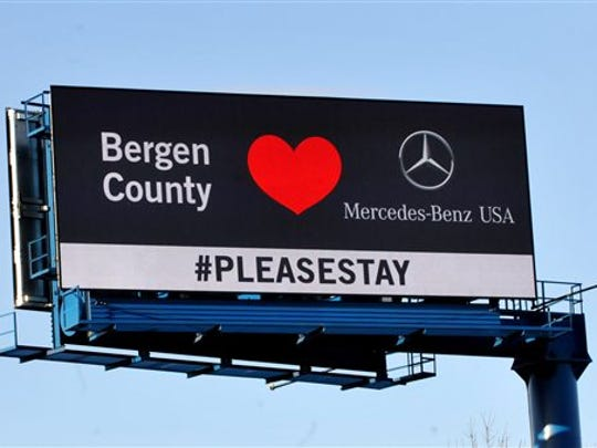 A billboard asking that Mercedes-Benz USA corporate headquarters remain in Bergen Country is displayed along Route 80 westbound in Rochelle Park in 2014. The German automaker decided to move to Atlanta.