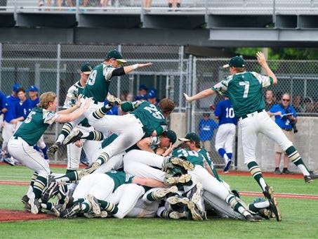 Ouachita Christian players celebrates a win over St. Edmund during the LHSAA Class 1A state baseballl championship game in Sulphur on Saturday.