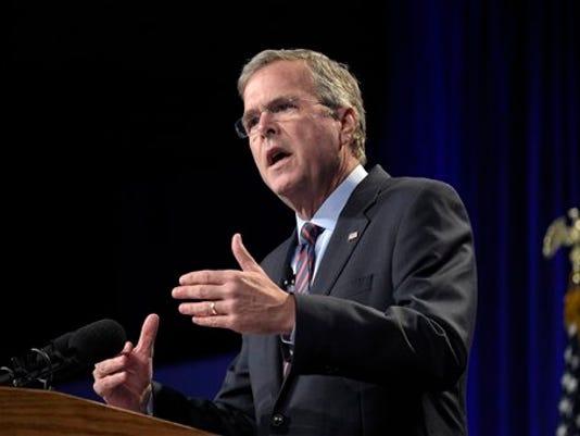 Former Florida Gov. Jeb Bush speaks at Rick Scott's Economic Growth Summit in Lake Buena Vista, Fla., Tuesday, June 2, 2015.