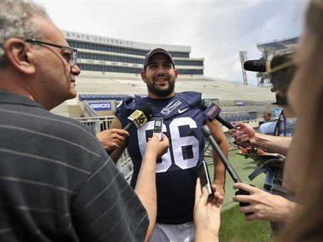 Penn State offensive lineman Angelo Mangiro laughs as he talks to reporters during media day at Beaver Stadium Thursday, Aug. 6, 2015 in University Park, Pa.