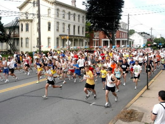 Runners take off at the starting line during a previous River Run.