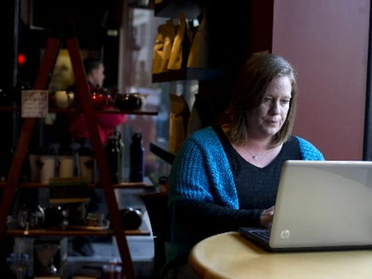 Brenda Lee Sieglitz of Lancaster uses her laptop at the Prince Street Cafe in Lancaster in 2011. Boitson comes to the cafe often to blog about her experiences. Her husband, Kevin, died unexpectedly in 2008 and she has used social media as a coping mechanism since then. (DAILY RECORD/SUNDAY NEWS -- FILE)