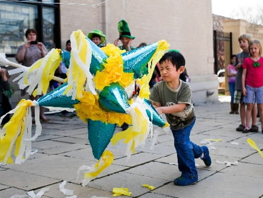 Isaac Beichler, then 5, of East Berlin, gives the pinata his best shot on during Multicultural Day in 2012. (FOR THE DAILY RECORD/SUNDAY NEWS -- FILE)