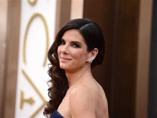 """FILE - In this March 2, 2014, file photo, Sandra Bullock arrives at the Oscars at the Dolby Theatre, in Los Angeles. People magazine has named Bullock as the """"World's Most Beautiful Woman"""" for 2015, the magazine announced, Wednesday, April 22, 2015."""