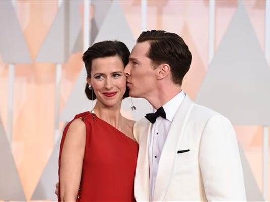 FILE - In this Feb. 22, 2015, file photo, Sophie Hunter, left, and Benedict Cumberbatch arrive at the Oscars in Los Angeles.