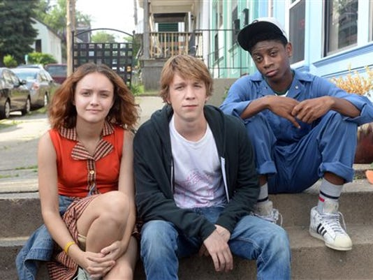 """This photo provided by Fox Searchlight Pictures shows, Olivia Cooke, from left, as Rachel, Thomas Mann as Greg, and RJ Cyler as Earl, in a scene from the film, """"Me and Earl and The Dying Girl."""""""