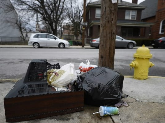 A television is accompanied by other trash as it sits on the curb on East King Street in York. Teresa Johnescu with the Olde Towne East neighborhood association says the television had been there for weeks.