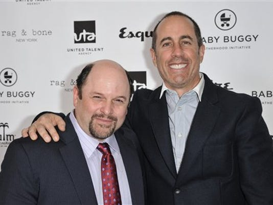 Jason Alexander, left, and Jerry Seinfeld attend the Inaugural Los Angeles Baby Buggy Fatherhood Lunch at Palm Restaurant on Wednesday, March 4, 2015, in Beverly Hills, Calif. (Photo by Richard Shotwell/Invision/AP)