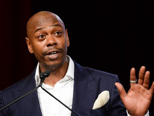 Comedian Dave Chappelle speaks on stage at the RUSH Philanthropic Arts Foundation s Art for Life Benefit at Fairview Farms in Water Mill on Saturday, July 18, 2015, in New York.