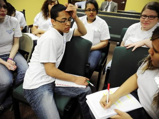 In 2012 , members of the Youth Court Alliance deliberated consequences for a youth truancy case.