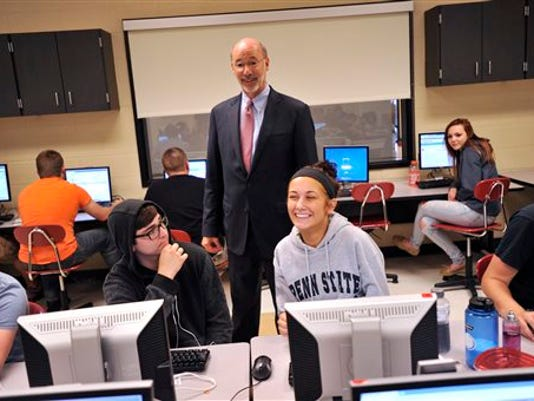 Gov. Tom Wolf visits a summer school classroom at the Bellefonte Area High School on Monday, July 13, 2015 in Bellefonte, Pa.   Wolf was outside the capital Monday, touting his budget agenda at schools in Bellefonte and Pittsburgh.  No negotiations between the Wolf administration and leaders of the Legislature's Republican majority are scheduled as Pennsylvania's budget stalemate approaches its third week.