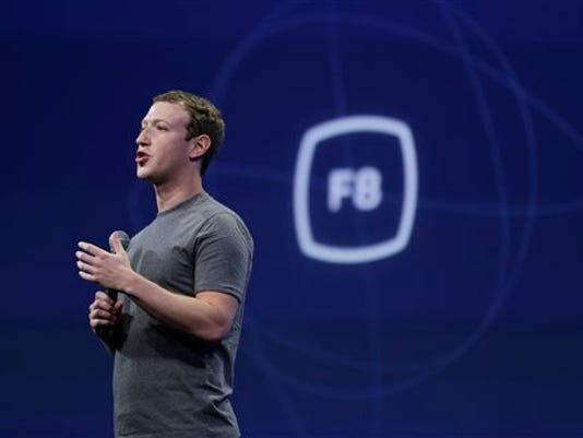 "In this March 25, 2015, file photo, CEO Mark Zuckerberg gestures while delivering the keynote address at the Facebook F8 Developer Conference in San Francisco. Zuckerberg said Tuesday, Sept. 15, Facebook may finally be getting a button that lets you quickly express something beyond a ""like."""