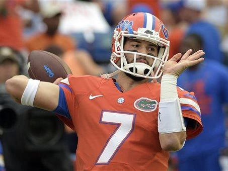 In this Oct. 3, 2015, file photo, Florida quarterback Will Grier warms up before an NCAA college football game against Mississippi in Gainesville, Fla. A person familiar with the situation says Grier has been suspended indefinitely for violating the NCAA's policy on banned drugs. The person spoke to The Associated Press on condition of anonymity because the school has not announced the decision. Grier is considering an appeal.