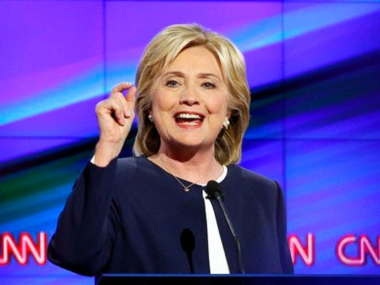 Hillary Rodham Clinton speaks during the CNN Democratic presidential debate Tuesday, Oct. 13, 2015, in Las Vegas. Clinton and Sen. Bernie Sanders clashed over U.S. involvement in the Middle East, gun control and economic policy in the first Democratic presidential debate, outlining competing visions for a party seeking to keep the White House for a third straight term.