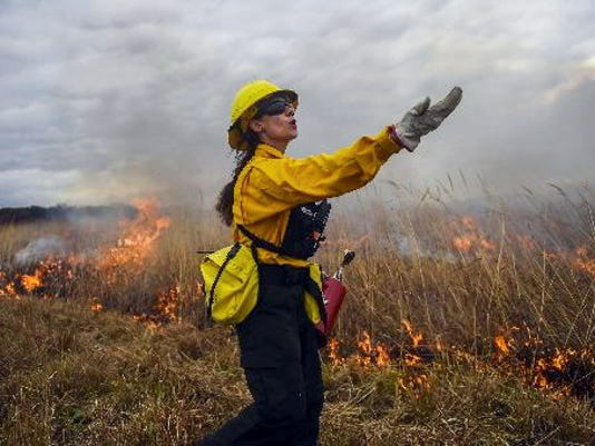 A firefighter yells to her group during a prescribed burn at the Gettysburg National Military Park in October. Park officials said they will try another controlled burn in the spring.