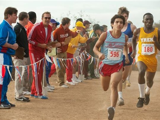 Kevin Costner, third from left, and Hector Duran, foreground right, appear in a scene from McFarland, USA.