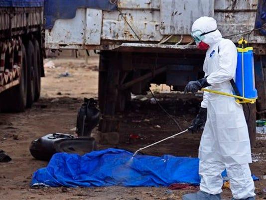 ebola-spray-liberia-monrovia.jpg