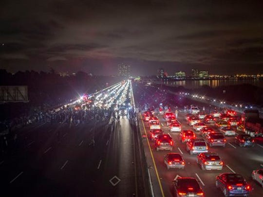 Protesters rallying against police violence block both directions of Interstate 80 in Berkeley, Calif., on Monday, Dec. 8, 2014. (AP Photo/Noah Berger)