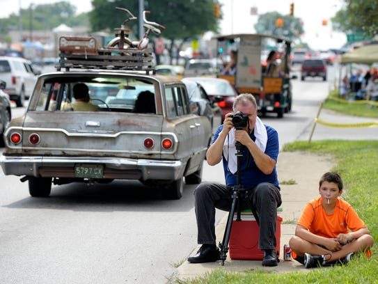 Chris Micha, 55, takes pictures of cruisers with his