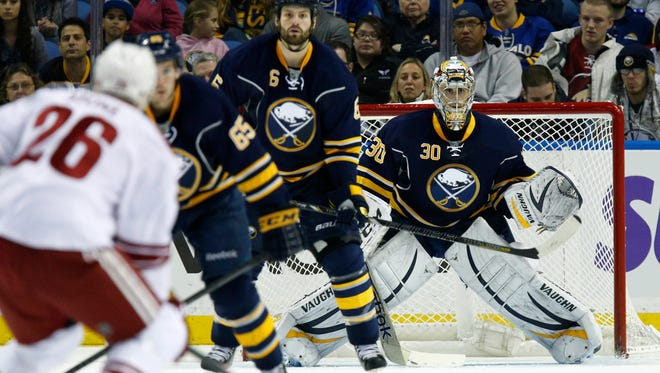 Buffalo Sabres goalie Ryan Miller watches as Phoenix Coyotes defenseman Michael Stone moves in to take a shot during the second period at First Niagara Center.